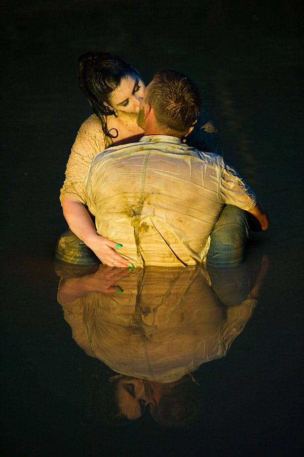 Engagement photo session of couple in the water.