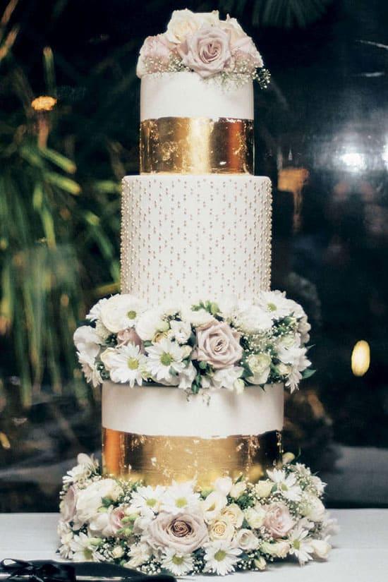 gold foil on white wedding cake