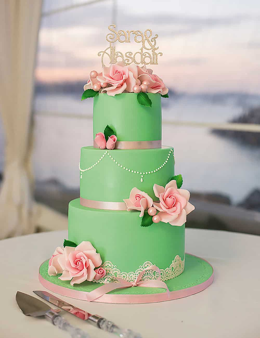 Delicious frosted green and pink ribbon wedding cake