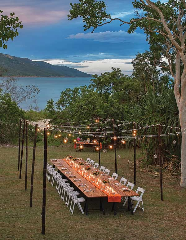 Al fresco dining under fairy lights by the sea