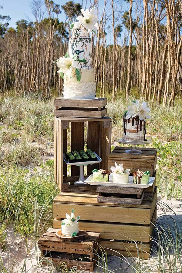 Dessert stand made out of wooden boxes for a coastal boho wedding