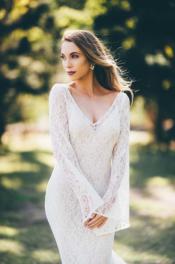 Bell sleeve lace Bellamy gown by Wendy Makin at BellaDonna Bridal.