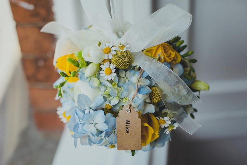 Yellow, blue, green and white bridal bouquet with sunflowers.