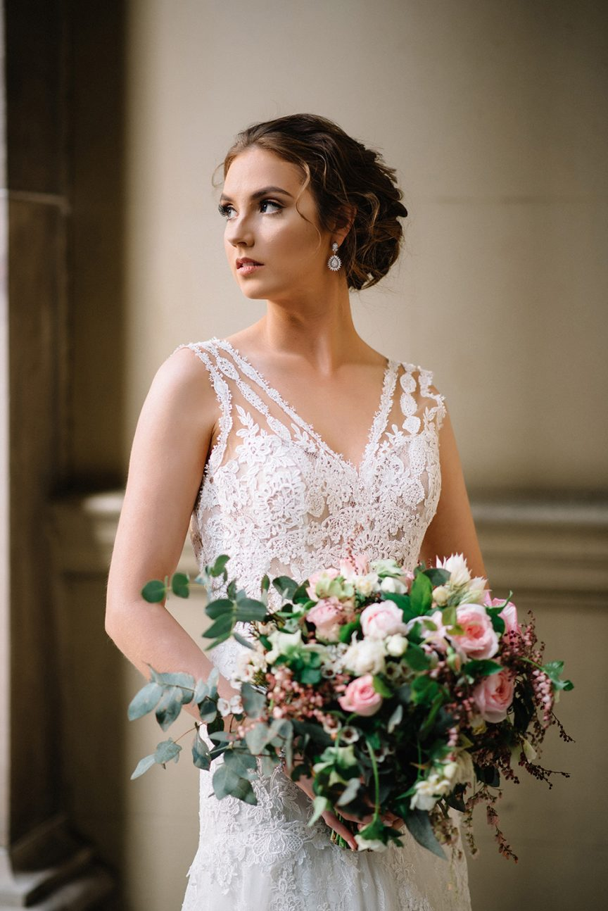 Bride with her pink, green and white wedding bouquet.