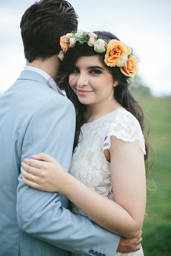 Bride wearing a flower crown with her groom.