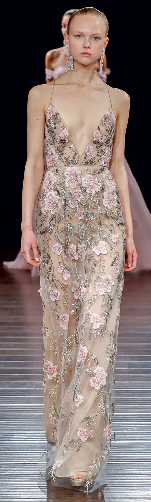 Sheer wedding gown with pastel pink embellished flowers from Naeem Khan.