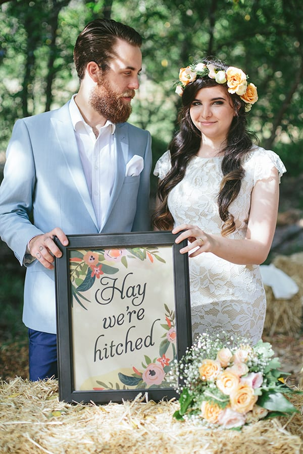 Playful signage 'Hay we're hitched' at a country farm wedding