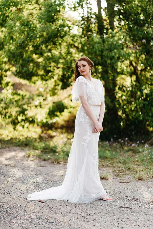 The Lisette sheer lace embroidered vintage wedding dress from BellaDonna Bridal.