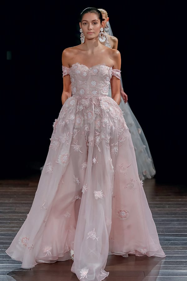 Off the shoulder pastel pink floral embroidered wedding gown by Naeem Khan.