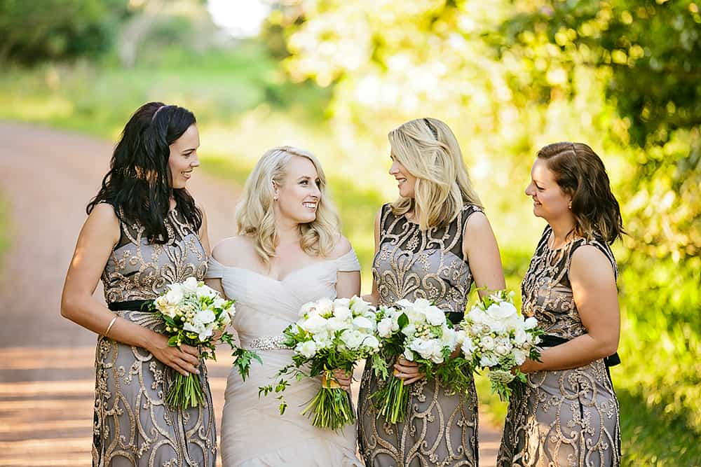 Nude & sheer black bridesmaid dresses with gold embroidery.