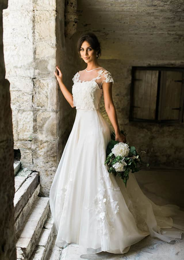 Sheer lace wedding gown from Toscano Bridal 's 2016 bridal couture collection.