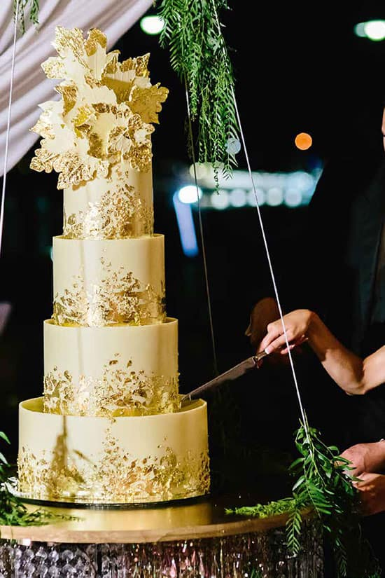 4 tier wedding cake with gold metallic foil