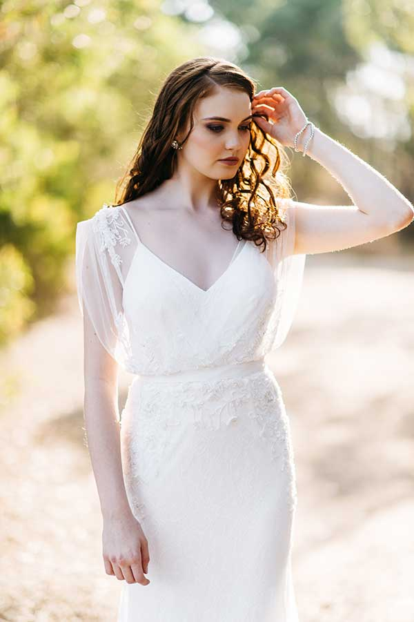 The Chantel vintage wedding styled gown with spaghetti strap and sheer sleeve from BellaDonna Bridal.