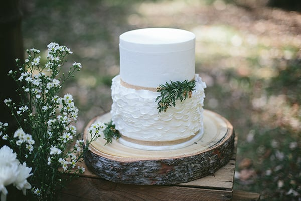 rustic wedding cake with natural elements featuring some flowers
