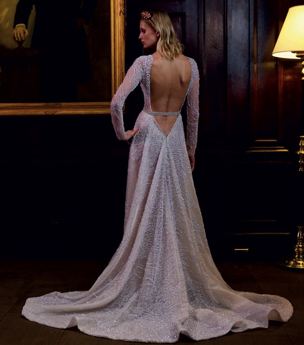 Stunning embellished wedding gown with a V cut-out back from Berta Bridal.