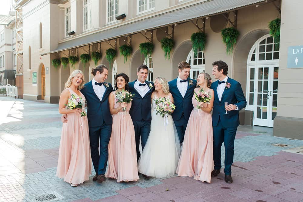 Blush pink bridesmaid dresses from Gowns of Elegance.