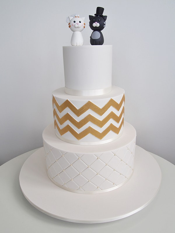 white and gold three tier wedding cake