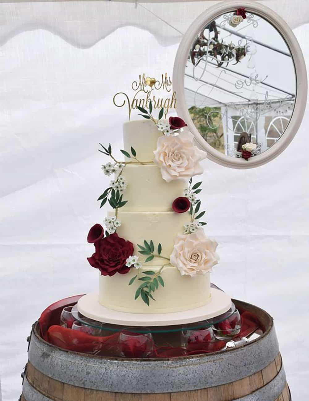 white wedding cake red flowers by Little Cake Lane