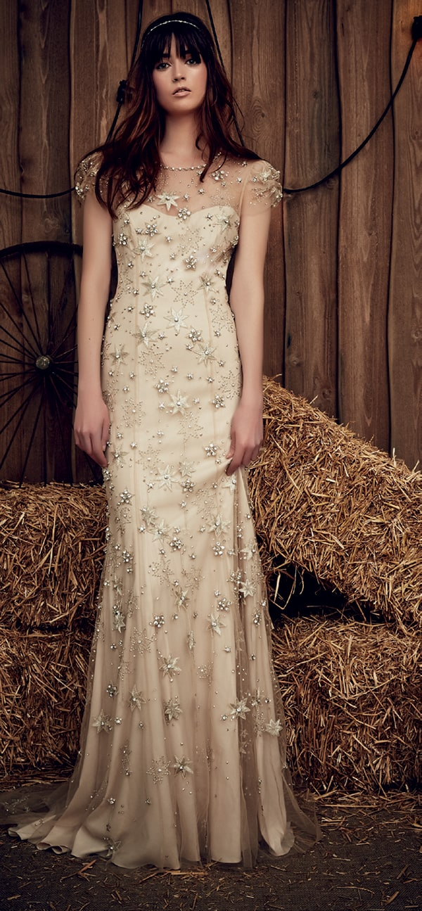 Pastel nude starry embellished wedding gown with sheer sleeves from Jenny Packham.