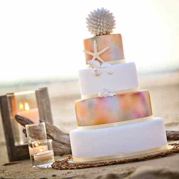 Tropical wedding cake on the beach.