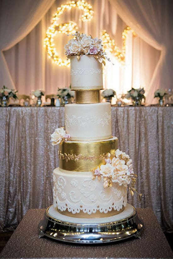 white wedding cake with gold foil