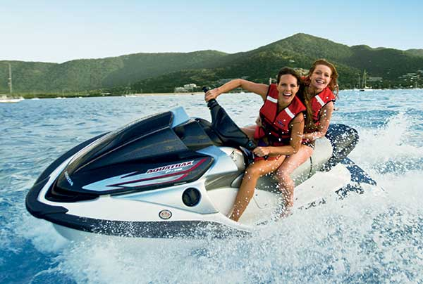 2 girls on a jetski at Airlie Beach