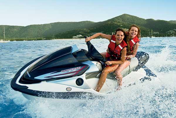 2 girls on a jetski at Airlie Beach