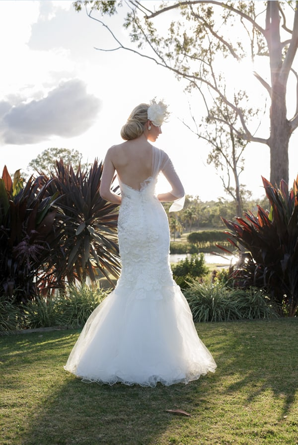 One shoulder wedding gown from Helena Couture Designs.