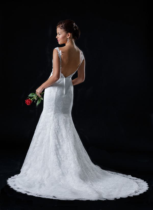Backless lace wedding gown by Strictly Bridal.