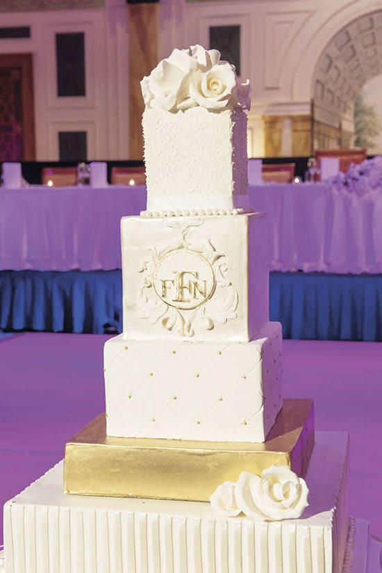 white wedding cake with gold foil base