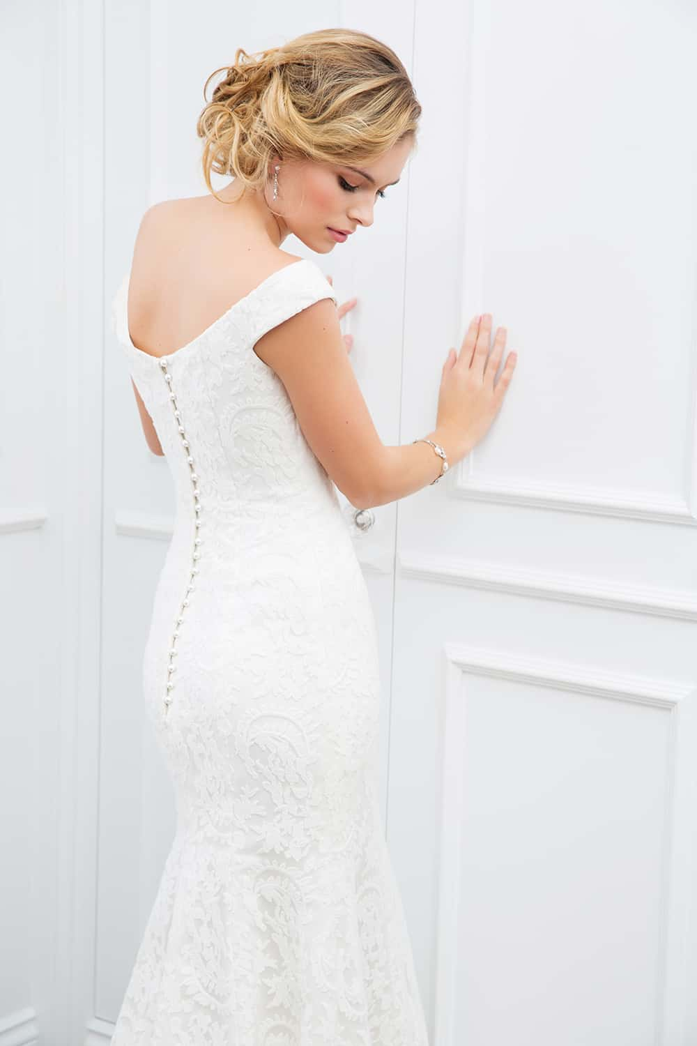 The Lena wedding gown, white off the shoulder with lace and button back from Wendy Makin Couture.