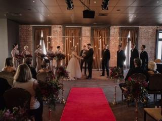 Indoor venue ceremony.