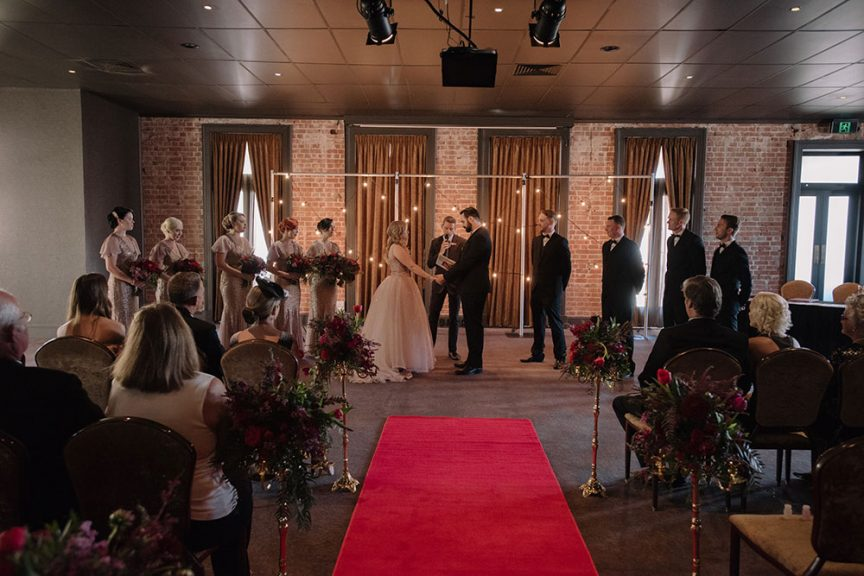 Indoor venue ceremony.