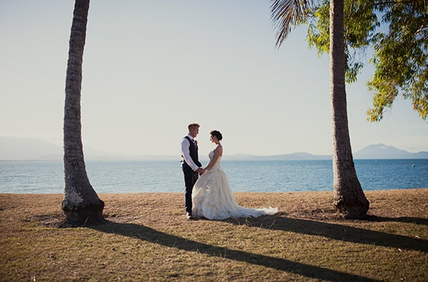 Bride and groom on a beach in North Queensland.