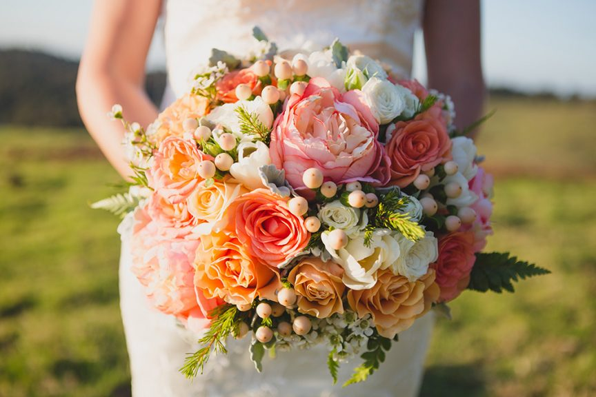 Round floral bouquet with coral, peach and white florals. Photo: Just For Love Photography.