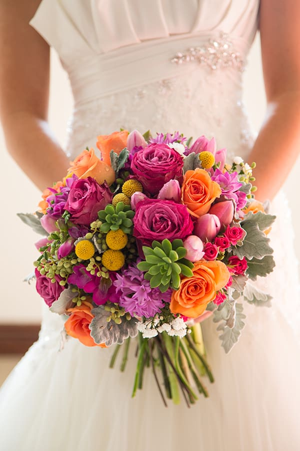 Pops of colour in this bridal bouquet. Photo: Milque