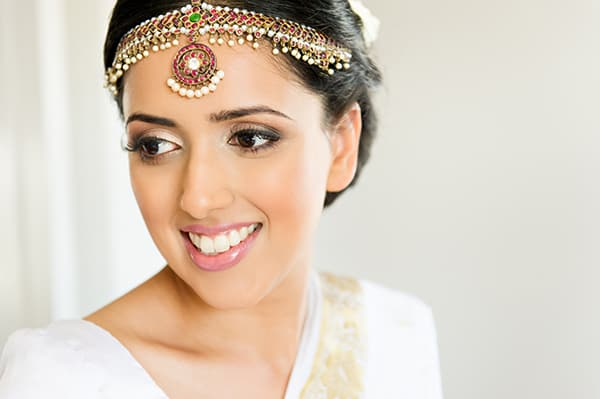 Traditional Indian bride Shamila wearing a beaded headpiece