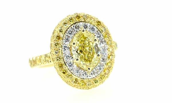 Oval shaped yellow diamond ring