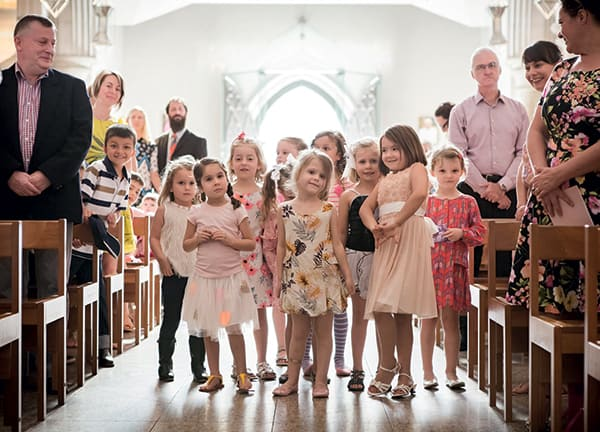Adorable kids at a wedding.