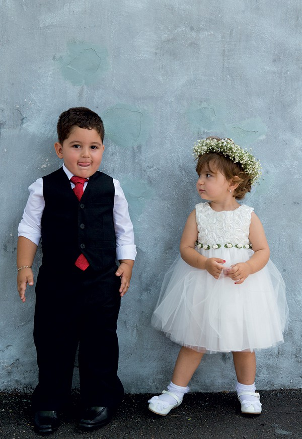 Kids at weddings: Adorable flower girl and ring bearer kids at a wedding.