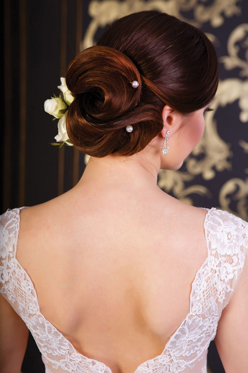 Slick up-do with pearls and roses.