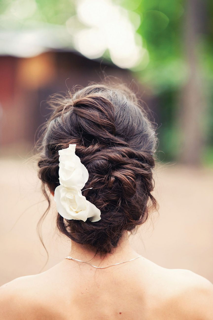 Braided up-do with white flower.