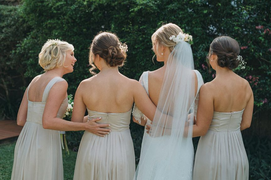 Bridetribe with loose curled up-do and baby's breath in their hair
