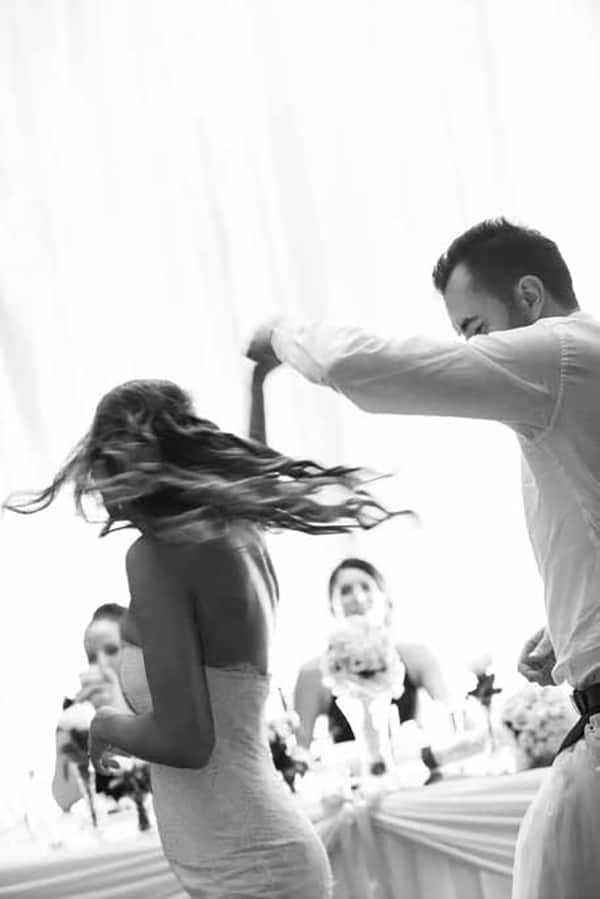Bride and groom dancing by Porfyri Photography