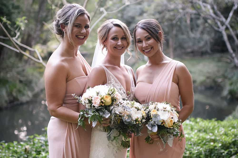 Dusty shades of pink, lemon, white and grey in these loose posies really suit the bridesmaids' dresses at the wedding of Grace and Steven.