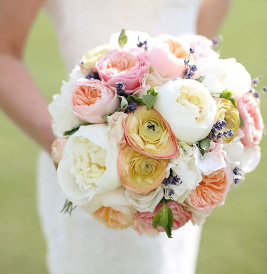 Round bouquet in pink, white and peach hues.