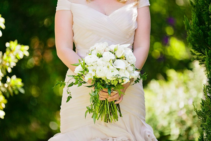Hand-tied white rose wedding bouquet.