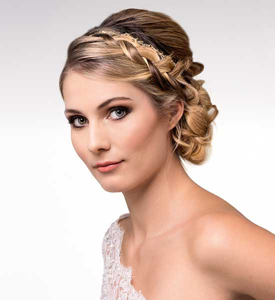Bridal up-do with braids by Latona's makeup, wearing a gown by Wendy Makin Couture.