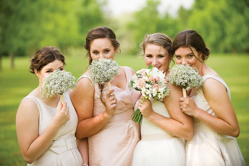 Bridetribe: bridesmaids wearing ivory and maid of honour in blush