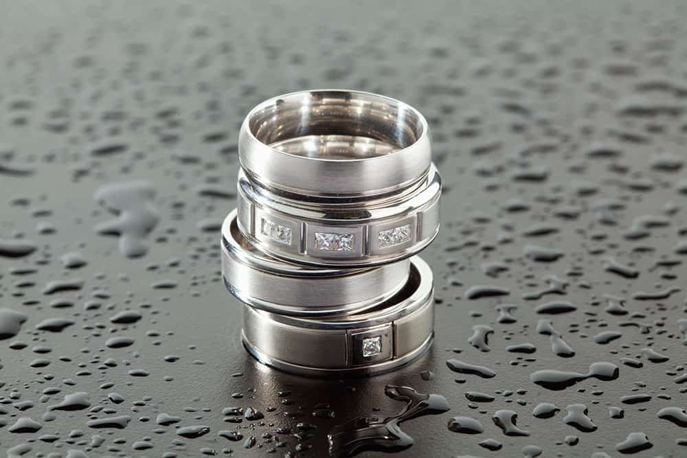 Stack of silver men's engagement rings